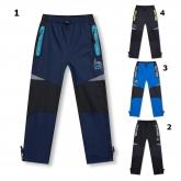KUGO D915 zateplené šusťákové kalhoty 98-128